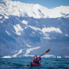 Laurel Winterbourne and Trevor Clark sea kayaking in Prince William Sound around Columbia Glacier. Valdez, Alaska.